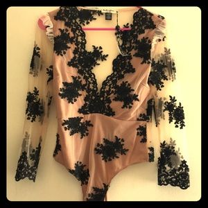 Nude body suit with black floral design
